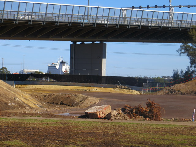 Road emerging from under the Westgate Bridge to connect with Cook St roundabout